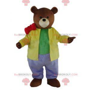 Medvěd hnědý maskot oblečený ve velmi barevném oblečení -