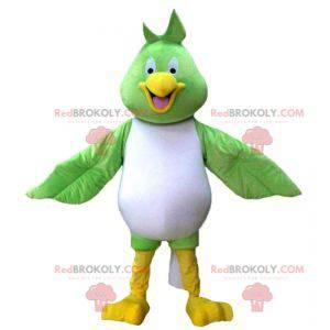 Mascote grande pássaro verde branco e amarelo muito sorridente