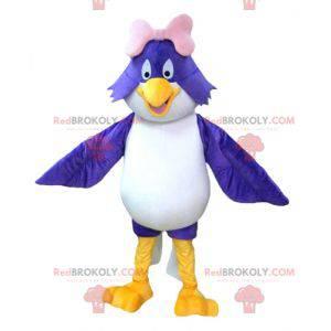 Mascotte grote blauwe en witte vogel met een roze strik -