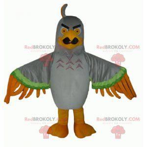 Szarozielono-pomarańczowa maskotka orła wyglądająca paskudnie -