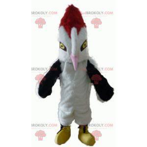 Mascotte bellissimo uccello bianco nero e rosso con un grande