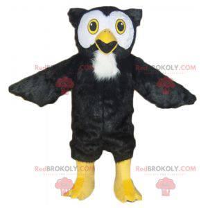 Celý maskot černé, bílé a žluté sovy - Redbrokoly.com
