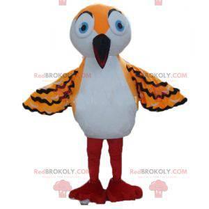 Mascote laranja branco e pássaro preto com um bico longo -