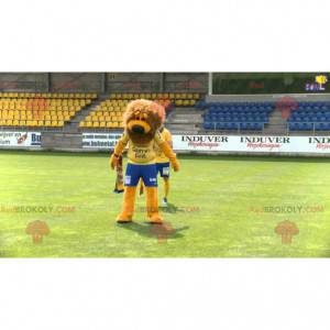 Oranžový a hnědý maskot lva ve sportovním oblečení -