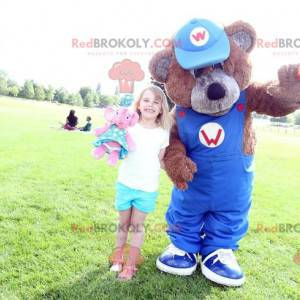 Maskot hnědý medvídek s modrým overalem - Redbrokoly.com