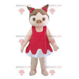 Rosa und braunes Schweinemaskottchen im roten und weißen Kleid