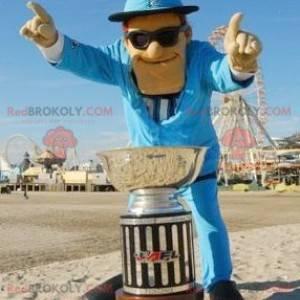 Maskotka mężczyzna ubrany w niebieski garnitur w okularach -