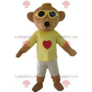 Brown teddy bear mascot in colorful outfit with glasses -