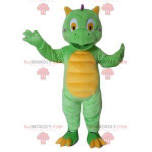 Roztomilý a barevný malý zelený a žlutý drak maskot -