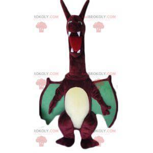Großes rotes und grünes Drachenmaskottchen mit großen Flügeln -