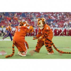 2 maskotki czarno-białych pomarańczowych tygrysów -