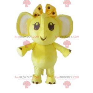 Maskottchen gelber und weißer Elefant mit einer Schleife auf