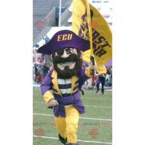 Mascote pirata com roupa tradicional amarela e roxa -