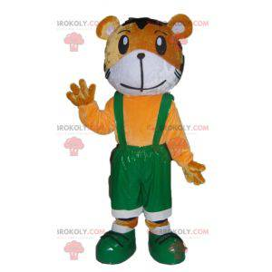 Orange und weißer Tiger Maskottchen in grünen Overalls -