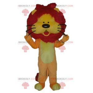 Orange gelbes und rotes Löwenmaskottchen mit einer hübschen
