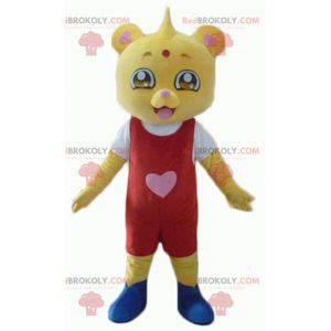 Gelbes Teddybärmaskottchen im roten und weißen Outfit -