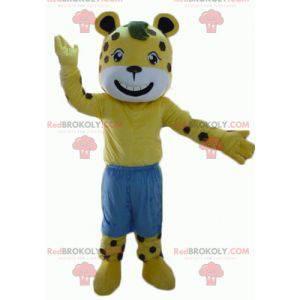 Žlutý a bílý tygr maskot s hnědými puntíky s kraťasy -