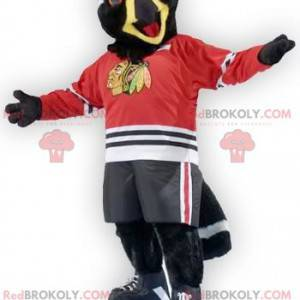 Černá a bílá maskot orla ptáka ve sportovním oblečení -