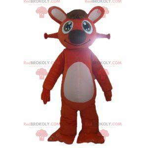 Very cute and smiling orange and white rabbit mascot -