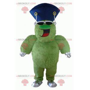 Sehr lächelndes haariges und pralles grünes Monstermaskottchen