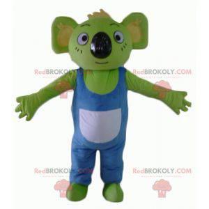 Mascota koala verde con overoles azules y blancos -