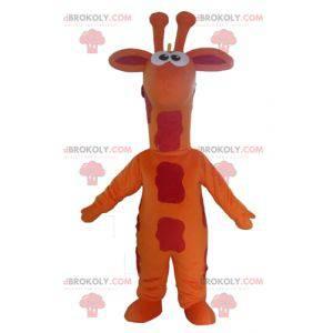 Gigantische oranje rood en geel giraffe mascotte -