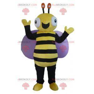Velmi usmívající se černý a žlutý včelí maskot - Redbrokoly.com