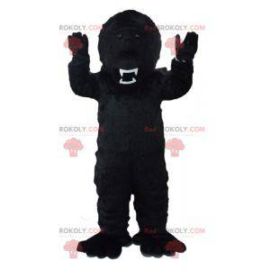 Mascota del gorila negro mirando feroz - Redbrokoly.com