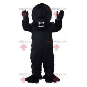 Schwarzes Gorilla-Maskottchen, das heftig aussieht -