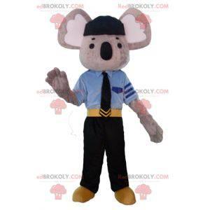 Mascote coala cinza e branco vestido com uniforme de policial -