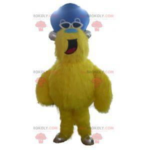 Alles haarige gelbe Monstermaskottchen mit Hut - Redbrokoly.com