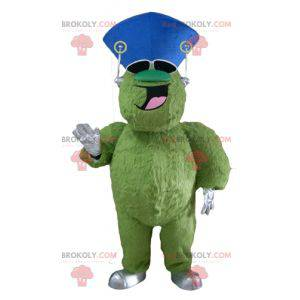 Very smiling hairy and plump green monster mascot -