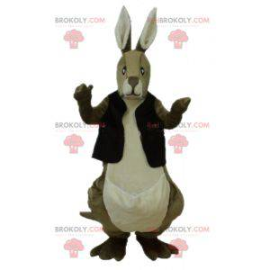 Brown and white kangaroo mascot with a black vest -