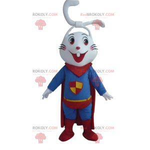 Very smiling white rabbit mascot dressed as a superhero -