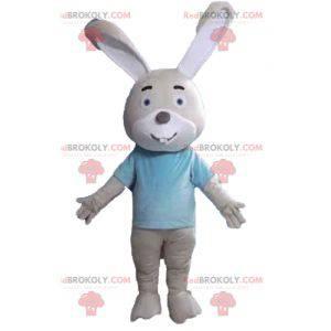 Béžový a bílý králičí maskot s modrým tričkem - Redbrokoly.com