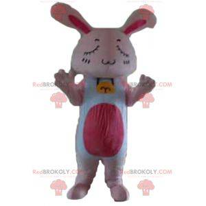 Giant pink and white rabbit mascot with closed eyes -