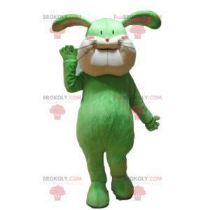 Měkký a roztomilý zelený a béžový maskot králíka -