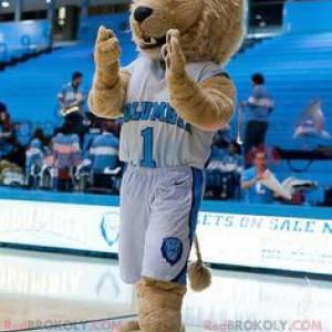 Béžový maskot lva v modrém a bílém sportovním oblečení -