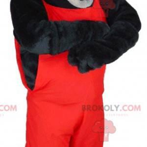Maskot svart og grå ulv i rød overall - Redbrokoly.com