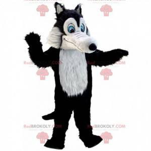 Maskot černý a šedý vlk, všichni chlupatí s modrýma očima -
