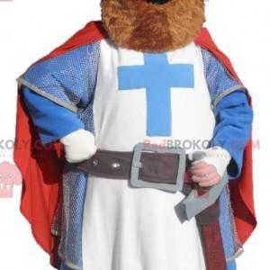 Rytíř maskot oblečený v červené, modré a bílé barvě -