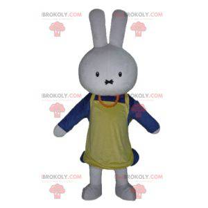 White rabbit mascot dressed in blue with an apron -