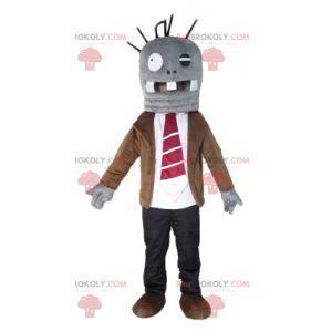 Sehr lustiges graues Monstermaskottchen in Anzug und Krawatte -