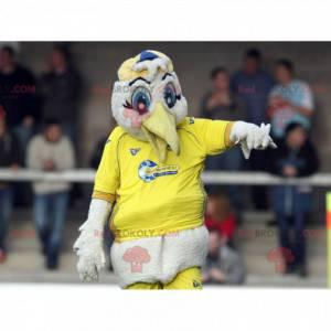 Maskot čáp bílý racek ve žlutém sportovním oblečení -