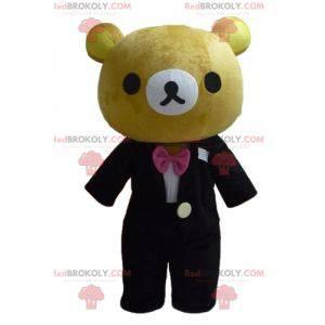 Maskot velký hnědý medvídek oblečený v pěkně černém kostýmu -