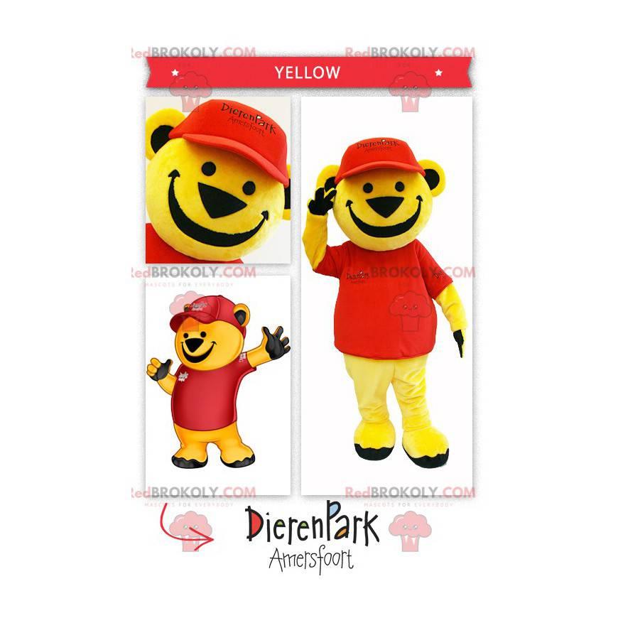 Velký žlutý medvěd maskot oblečený v červené barvě -