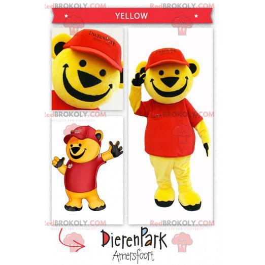 Stor gul bjørnemaskot kledd i rødt - Redbrokoly.com