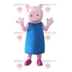 Rosa Schweinemaskottchen mit einem blauen Kleid - Redbrokoly.com