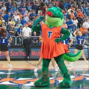 Zielony krokodyl maskotka w czerwonej sukience - Redbrokoly.com