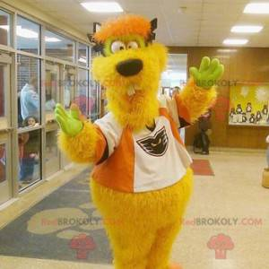 Yellow and orange monster mascot funny and hairy -